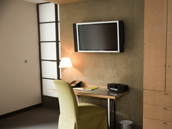 Desk and chair with wall-mounted flat screen TV